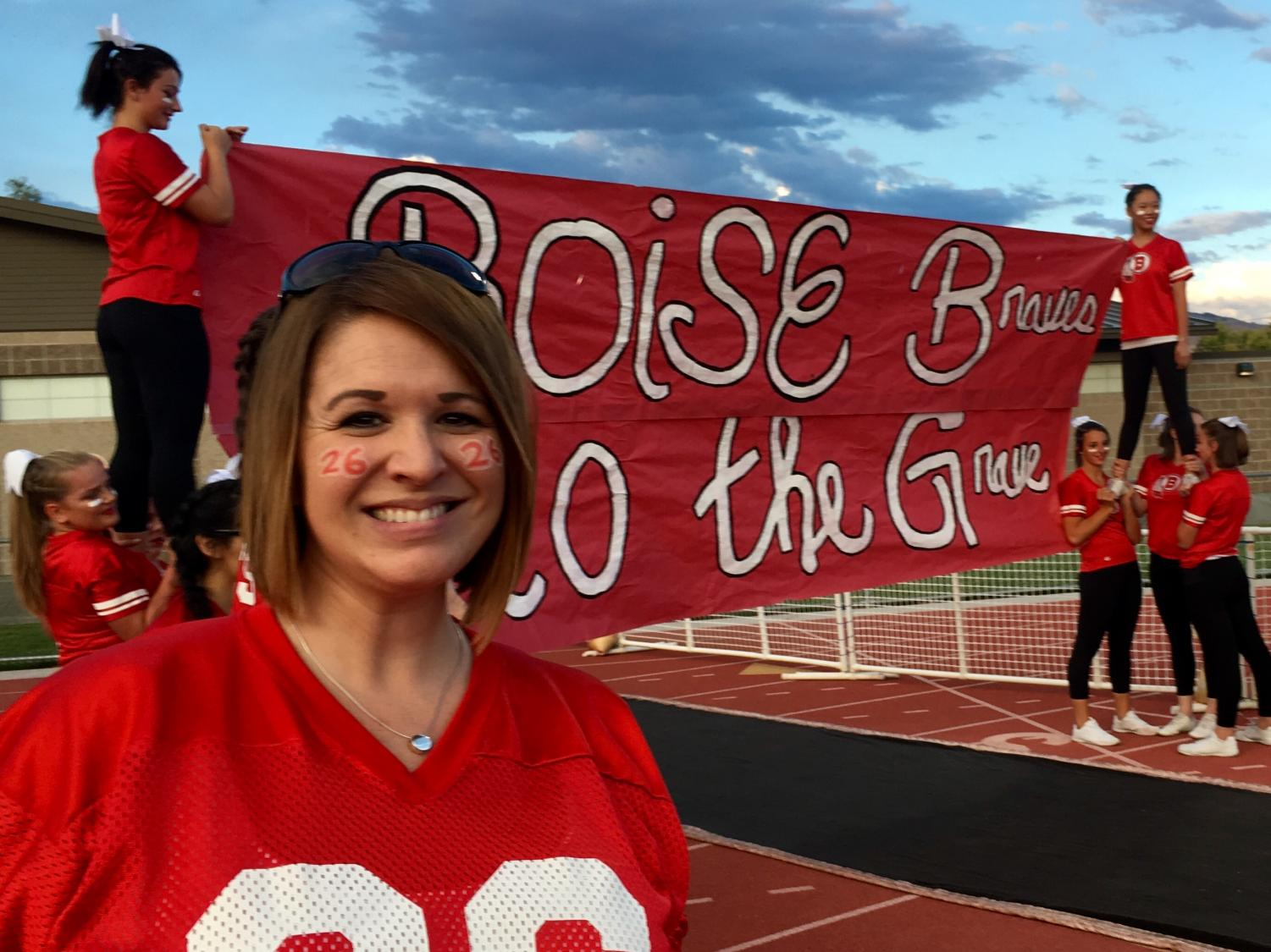 Mrs.Kathryn Rotchford, a Boise High English teacher, smiles as she gets ready to help make the tunnel at the 2016 Boise High Homecoming football game.