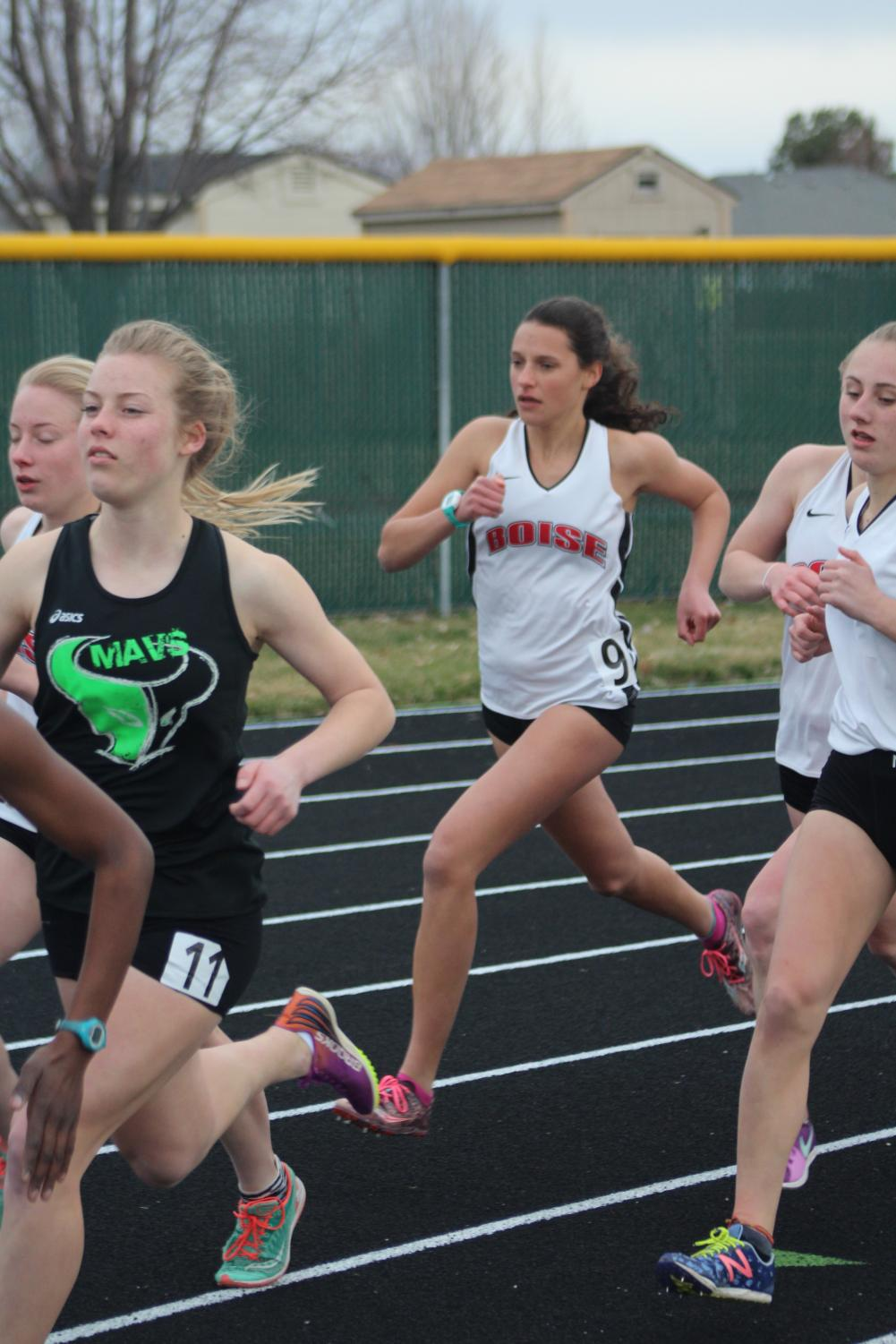 Long-distance athletes battle it out against other schools in the mile run.