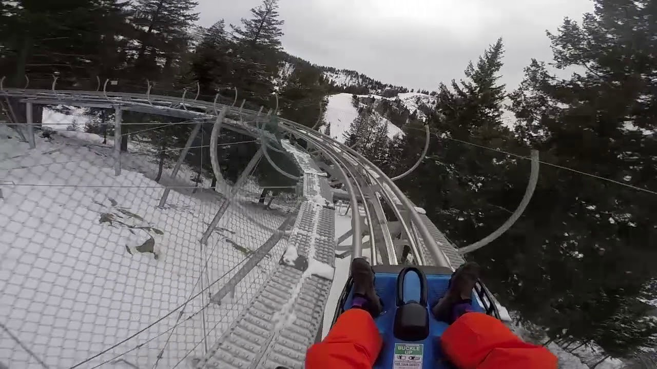 A snapshot of an enthusiastic snow goer as he videos his experience riding the Bogus Basin Glade Runner.