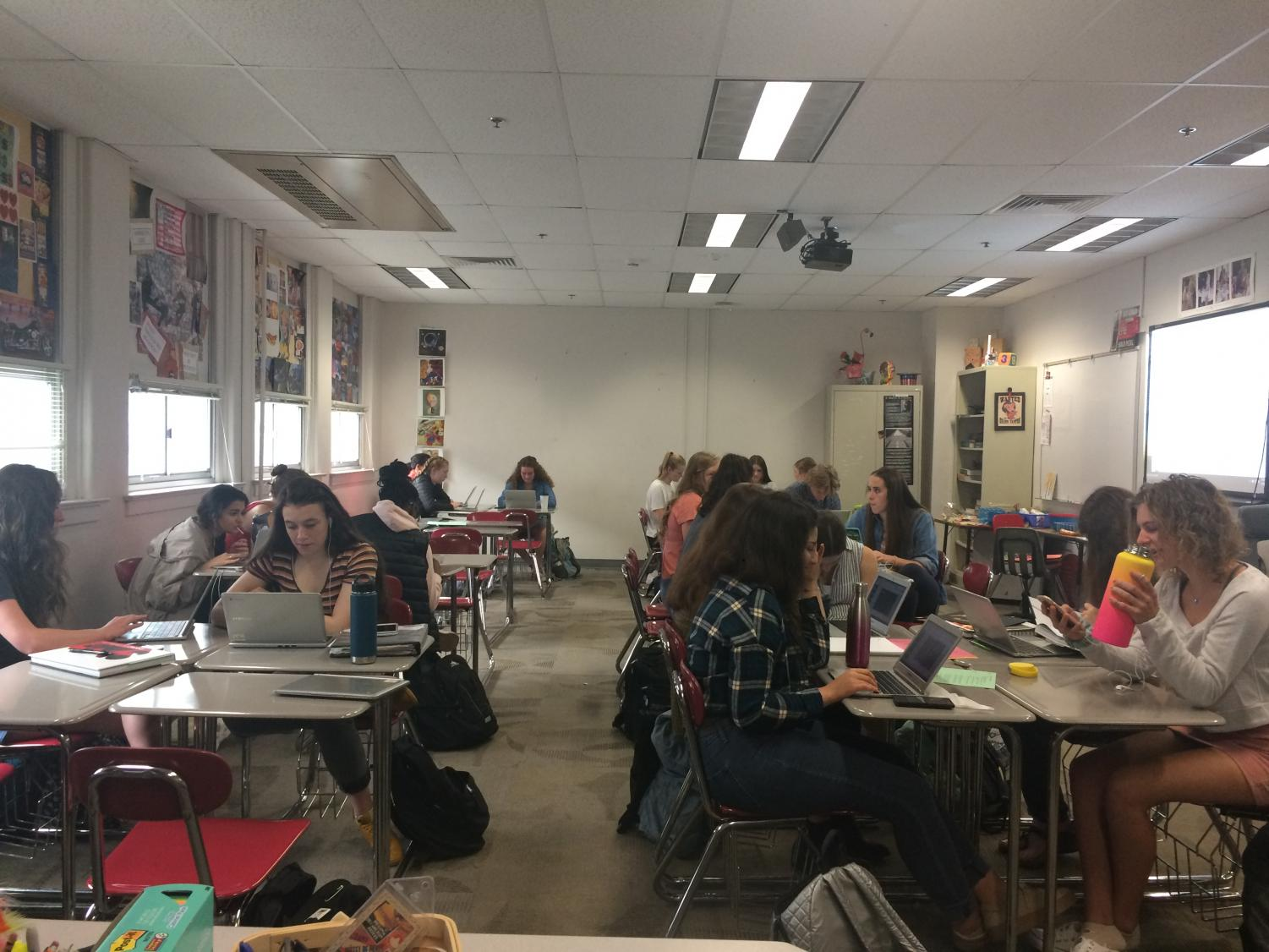 AP Language and Composition students work diligently on a group project.