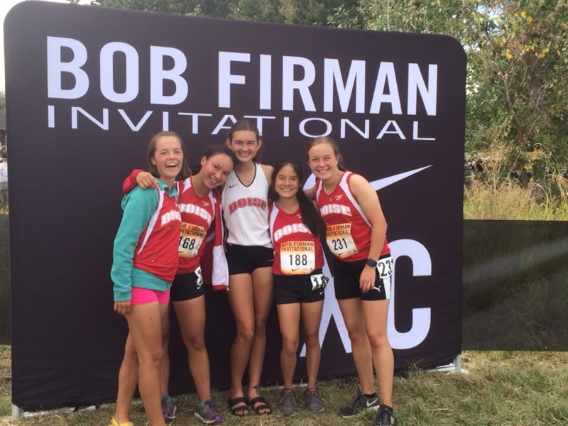 Sarah Hammond and her teammates post-race at the Bob Firman invitational in Eagle Island.