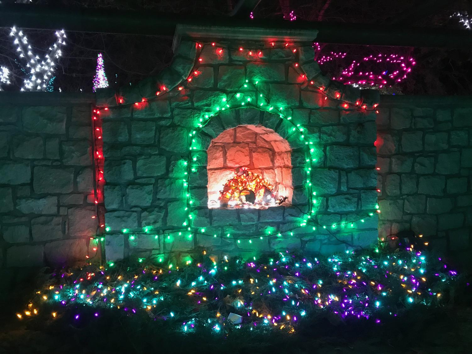 One of the beautiful glowing displays at the 2018 Winter Garden aGlow depicting a fake fireplace sparkling in the moonlight.