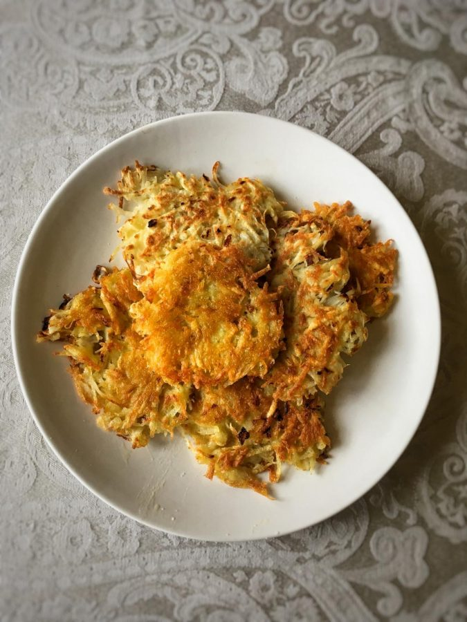 Shredded potatoes are mixed with onions and two eggs, then fried to get a nice, crispy latke. Serve with sour cream or applesauce for the true flavor of Hanukkah.