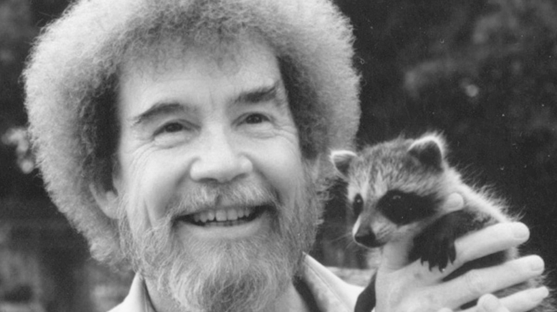 A photograph of Bob Ross, with his now famous afro and beard on display.