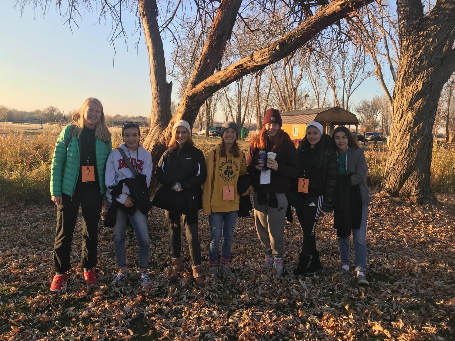 Megan Bass, Gracie Maulik, Ella Schmitz, Caitlin Atkins, Sophia Martin, Alana Cronin, Kyra Cronin (left to right)  BHS Sophomores and Juniors volunteering at the Nike Regionals Cross Country Meet. What a great way to help out the community!