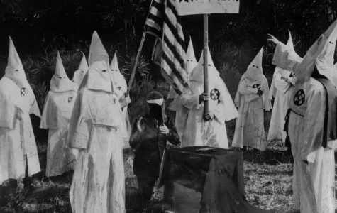 KKK recruitment ceremony in 1922 (Topical Press Agency/Getty Images).