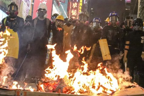 A picture of Hong Kong protesters dressed in similar garb to what Blitzchung was wearing in the controversial video