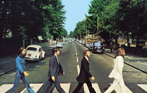 The iconic Abbey Road album cover featuring John Lennon in white, Ringo Starr dressed in black, Paul McCartney without shoes, and George Harrion in denim.