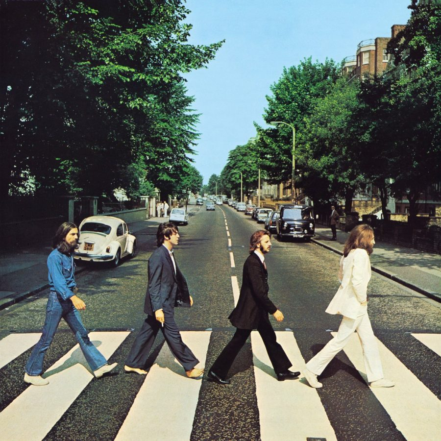 The+iconic+Abbey+Road+album+cover+featuring+John+Lennon+in+white%2C+Ringo+Starr+dressed+in+black%2C+Paul+McCartney+without+shoes%2C+and+George+Harrion+in+denim.