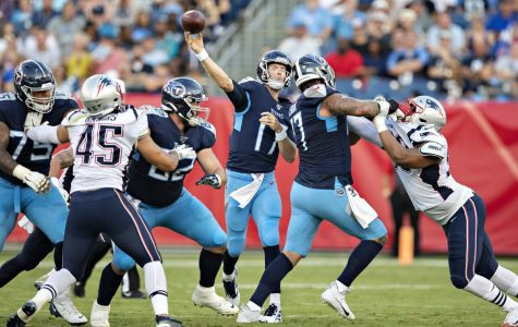 Tennessee Titans quarterback, Ryan Tannehill, throwing a pass during the Patriots v. Titans week one playoff game (Wesley Hitt/Getty Images).