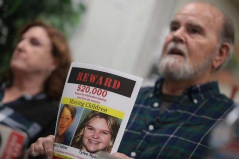 Kay and Larry Woodcock, the grandparents of JJ Vallow and Tylee Ryan, holding up a reward poster of their missing grandchildren as they talk to Rexburg media.