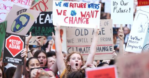 Students protesting and calling for their government to take action against climate change. (Mark Metcalfe/Getty Images)