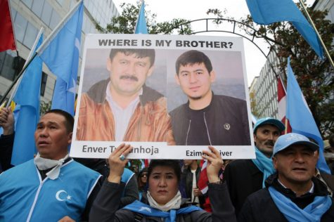 Uyghur Muslims protesting the disappearance and encampment of their people (Aris Oikonomou/ AFP via Getty Images).
