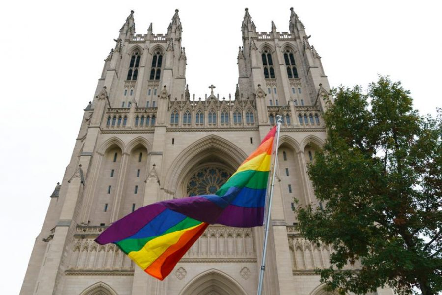 An image of a pride flag, a symbol of solidarity and pride for the LGBTQ+, community being displayed outside a church to show support. (AP/Carolyn Kaster)