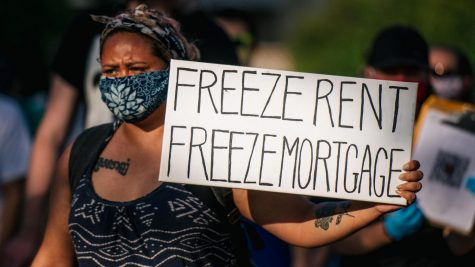 A protester calls for the government to halt payment on rent and mortgage during a demonstration in Minneapolis. BRANDON BELL / GETTY IMAGES
