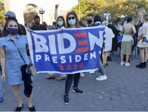 People celebrating the AP calling the election for Joe Biden at Washington Square Arch in New York City. (Leslie Bock)