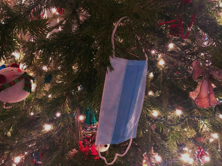 A mask hanging on a Christmas tree like an ornament to show the way the holidays have shifted this year in that COVID feels all encompassing. (Bella Rock)