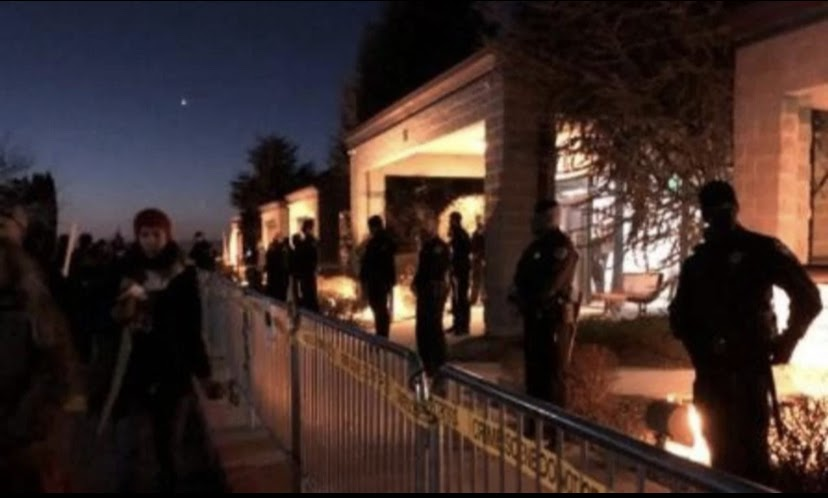 Police stand outside where the Central District Health meeting was taking place due to protesters. (photo credit: KBOI TV, CBS news)