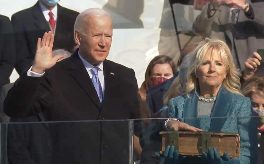 President Joe Biden takes the presidential oath beside his wife, Fist Lady Dr. Jill Biden.
