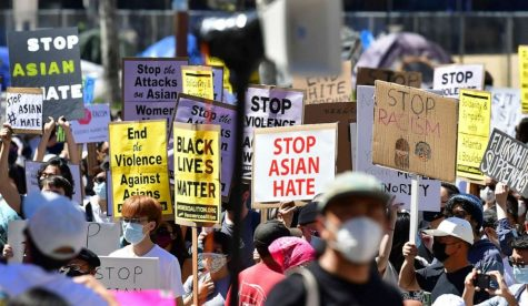 A group rallying against anti-Asian American and Pacific Islander sentiment and hate at City Hall in Los Angeles. (Frederic Brown/ Getty Images)