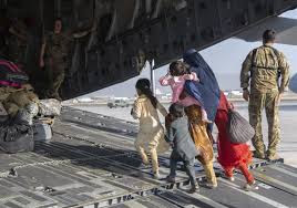 """""""An Afghan family being evacuated by the US air force from the airport in Kabul."""""""